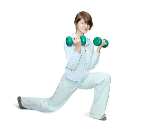 activewear: girl in blue activewear is doing fitness exercises with barbell
