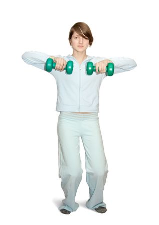 activewear: girl in light activewear is doing fitness exercises with barbell