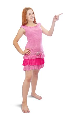 girl in pink dress pointing away, over white background Stock Photo - 5717452