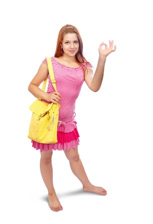 girl in pink dress with yellow handbag pointing OK photo