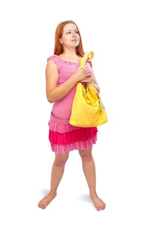 girl in pink dress with yellow handbag over white photo