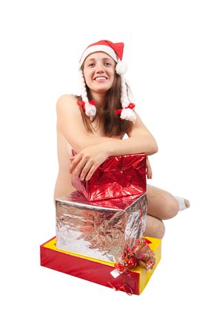 Femme nue dans un chapeau de Père Noël avec des cadeaux de Noël Banque d'images - 5717586