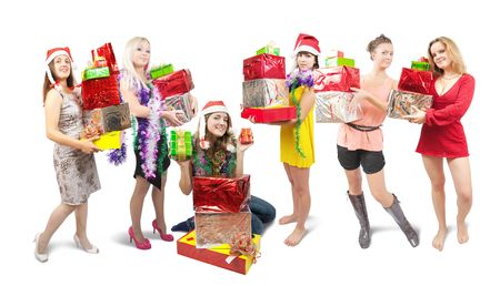 happy teenage girl  sitting with gifts scattered around her and other girls Stock Photo - 5742116