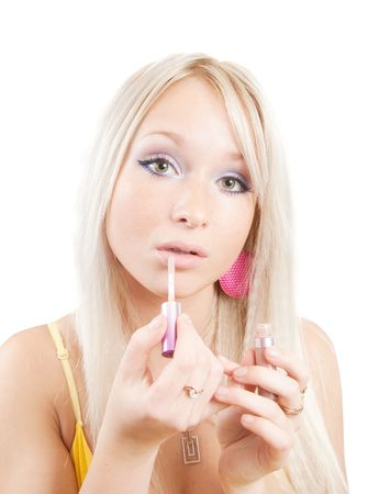 Blonde girl paints lips with lipstick over white Stock Photo - 5787636
