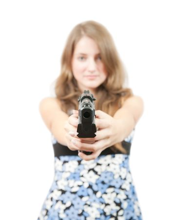 Brunette girl in blue dress with gun. Focus on gun only Stock Photo - 5812112