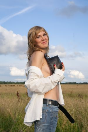 cowgirl in jeans with a cowboy hat at nature Stock Photo - 5830584