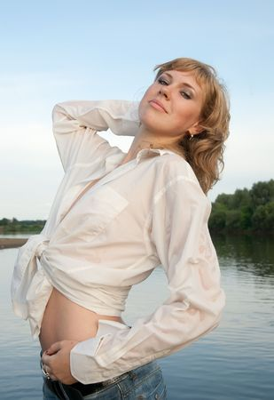 sexy blonde girl in white wet shirt against river Stock Photo - 5830583