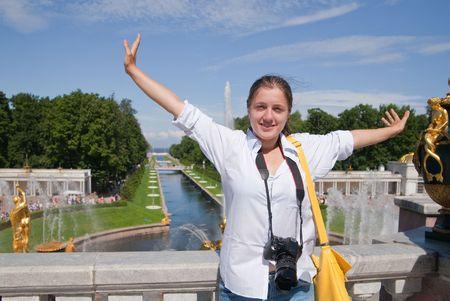female tourist against Fountains of Petergof, Saint Petersburg, Russia  photo
