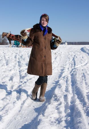horse sleigh: girl in russian traditional clothes  against  Russian landscape