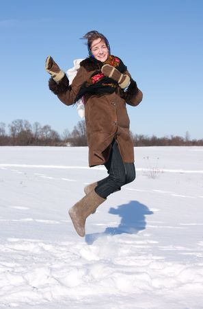 kisser: girl in russian traditional clothes jumping against  winter landscape