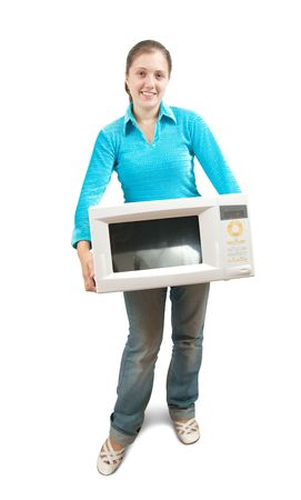 Young woman in blue with mini oven. Isolated over white photo