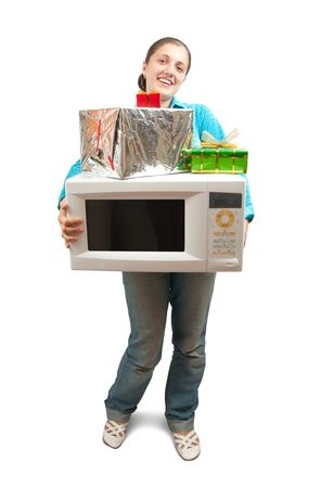mini oven: Girl in blue with microwave oven and present boxes. Isolated over white