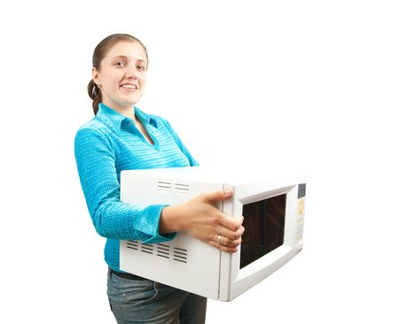 microwave oven: Chica en azul con horno de microondas. Aislados sobre blanco