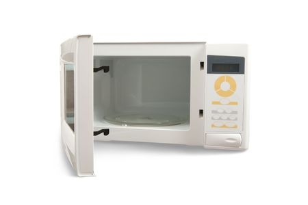 mini oven: New microwave oven. Isolated on white background Stock Photo