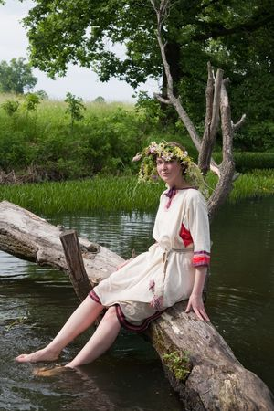 seamaid: girl  in russian traditional clothes against river