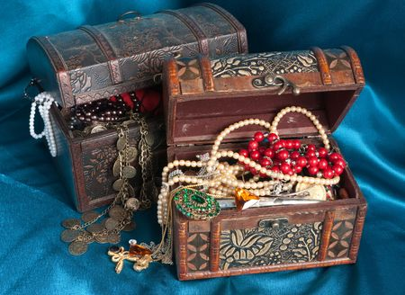 Two wooden treasure chests with valuables on blue textile Stock Photo - 5855581
