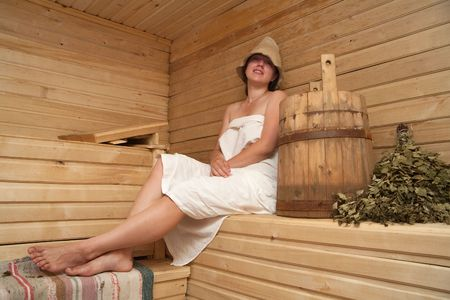 washhouse: Young woman is taking a steam-bath  at sauna  Stock Photo