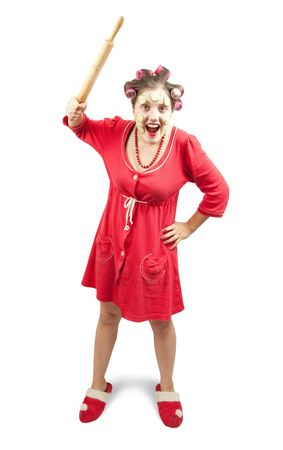Crazy housewife in red, isolated on a white background  photo