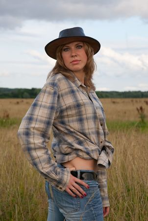 cowgirl in jeans and a cowboy hat at nature Stock Photo - 5873480