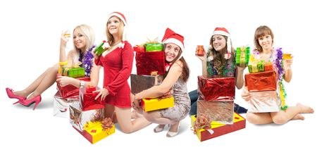 Girls sitting with gifts scattered around their photo