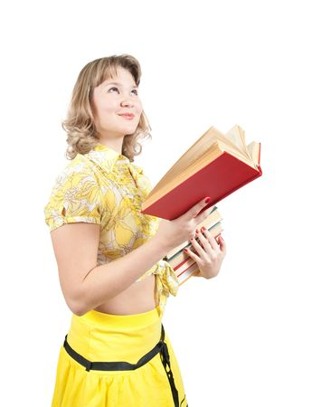 student dressed in yellow with book, isolated over white Stockfoto