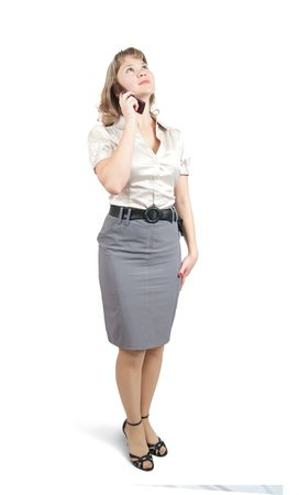 Beautiful girl in business outfit speaking by mobile photo