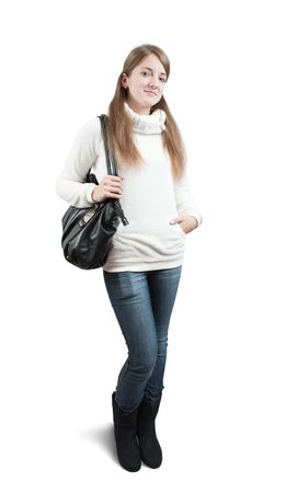 Long-haired teen girl in sweater with handbag photo