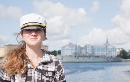 female tourist against Aurora cruiser museum, Saint-Petersburg, Russia  Stock Photo - 5918100