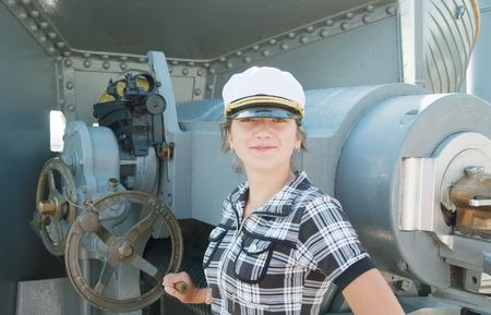 female tourist near cruiser cannonry  from St.Petersburg  photo