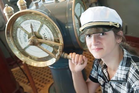 maneuvering: young girl near  speed telegraph transmitter on old cruiser