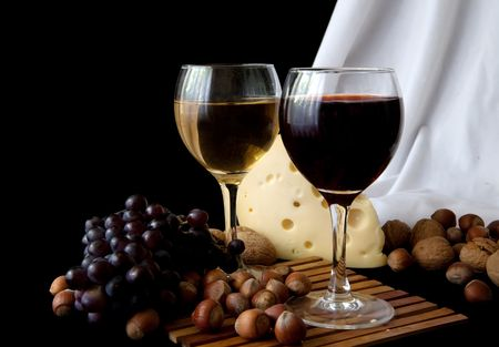 nit: Grapes and cheese with glass of red wine on a black background Stock Photo