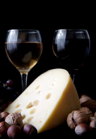 nit:  cheese and glass of wine on a black background Stock Photo