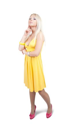 velure: Standing girl in  yellow dress. Isolated with clipping path