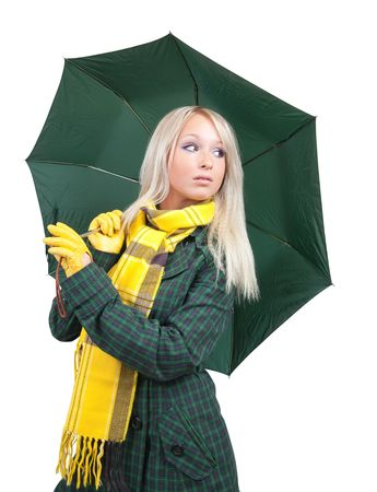 Blonde girl  in green coat  with umbrella over white  photo
