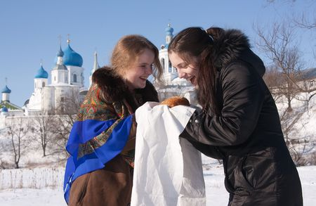 pancake week: Two girl play during Pancake Week at Russia