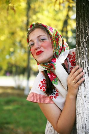 teener: girl in russian traditional clothes against autumn park Stock Photo