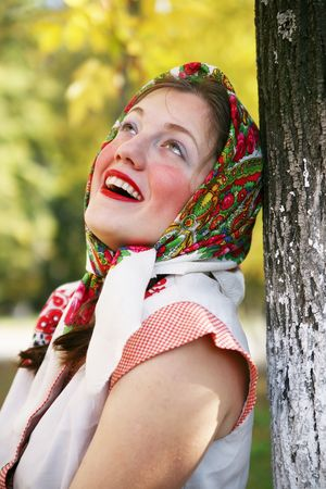 girl in russian traditional clothes against autumn park Stockfoto