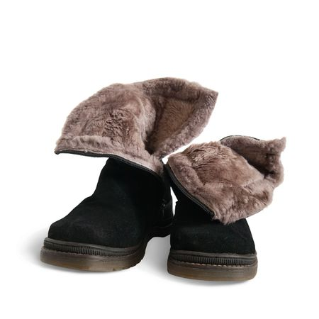 furskin: Black fur womans boots  isolated on white background  Stock Photo