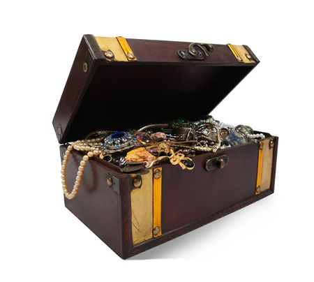 Wooden treasure chest with bijouterie photo