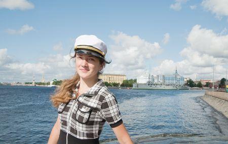 female tourist against Aurora cruiser museum, Saint-Petersburg, Russia  photo
