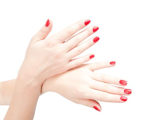 Woman hands with red nails. Isolated on white. photo