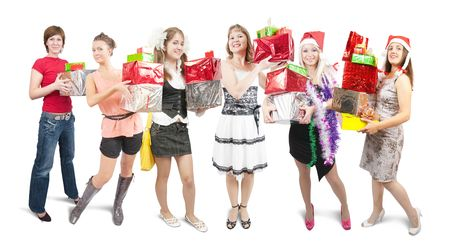 Group of beauty girls with christmas gifts over white photo