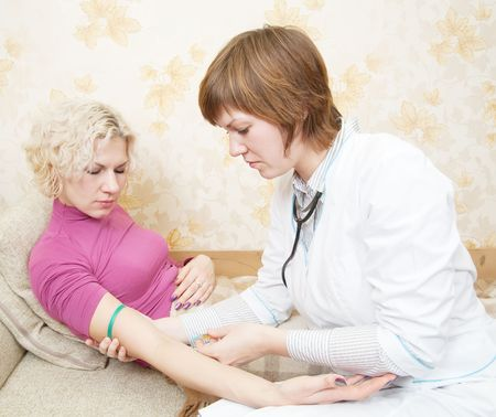 Doctor giving a girl an intravenous injection in her forearm photo