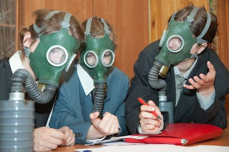 The girls in a gas mask at nterior Stock Photo - 6045202
