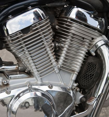 Closeup of a big shiny motorcycle engine photo