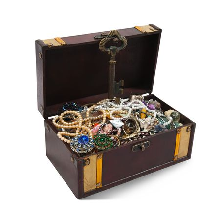 wooden treasure chest with valuables and gem, isolated over white background photo