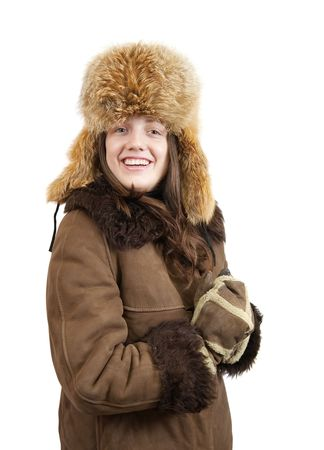 Girl in sheepskin coat and fox cap on white background photo