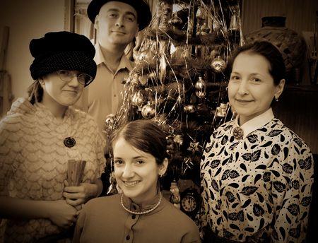 Vintage photo of Family near Christmas tree at home Stock Photo - 6064069