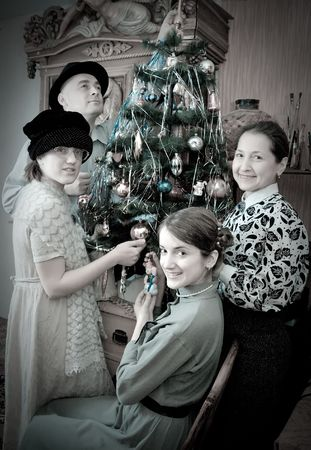 Retro photo of Family near Christmas tree at home Stock Photo - 6064045