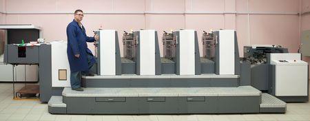 Printer working at his modern offset machine Stock Photo - 6064073